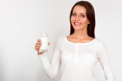 Woman holding milk against a white background Royalty Free Stock Photo