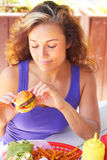 Woman Holding a Mini Burger Royalty Free Stock Photo