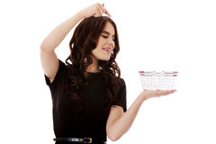 Woman holding mini shopping cart Royalty Free Stock Photo