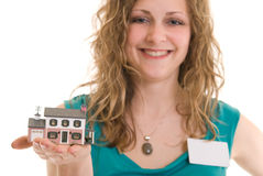 Woman holding miniature house Stock Images