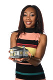 Woman Holding Miniature House. African American businesswoman holding miniature house isolated over white background -Selective Focus on hands royalty free stock photography