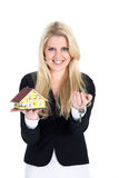 Woman holding a miniature house an key Stock Images