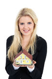 Woman holding a miniature house Stock Images