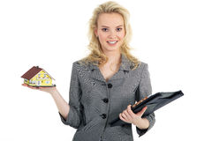 Woman holding a miniature house Stock Image