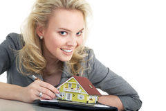 Woman holding a miniature house Royalty Free Stock Image