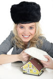 Woman holding a miniature house Stock Photography