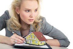 Woman holding a miniature house Royalty Free Stock Photos