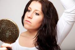 A Woman Holding a Mirror Royalty Free Stock Photos