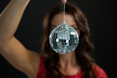 Woman holding mirror ball. Close-up of woman holding mirror ball Royalty Free Stock Images