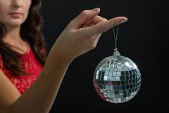 Woman holding mirror ball. Mid section of woman holding mirror ball Royalty Free Stock Photos
