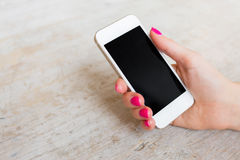 Woman holding mobile phone Royalty Free Stock Photo