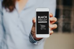Black Friday shopping app in a mobile phone screen. Stock Image