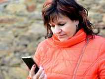 Woman holding the mobile phone Stock Images