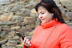 Woman holding the mobile phone Stock Image