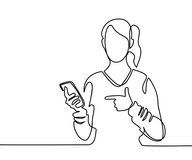 Woman holding mobile phone and pointing finger Royalty Free Stock Image