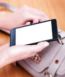 Woman holding mobile smart phone Stock Photography