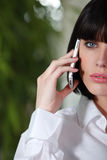 Woman holding mobile telephone Stock Photography