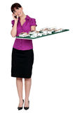 Woman holding model housing. Woman holding scale model of housing Royalty Free Stock Image