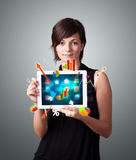 Woman holding modern tablet with colorful diagrams Royalty Free Stock Image