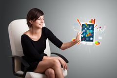 Woman holding modern tablet with colorful diagrams and graphs. Beutiful woman holding modern tablet with colorful diagrams and graphs Stock Image
