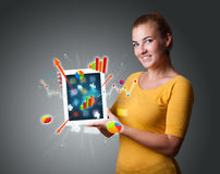 Woman holding modern tablet with colorful diagrams and graphs Royalty Free Stock Photos