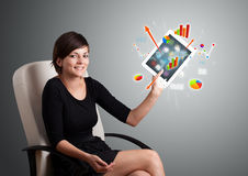 Woman holding modern tablet with colorful diagrams and graphs Royalty Free Stock Photography