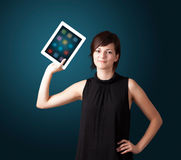 Woman holding modern tablet with colorful icons Stock Photography