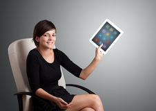 Woman holding modern tablet with colorful icons Royalty Free Stock Photo