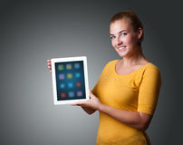 Woman holding modern tablet with colorful icons Stock Images