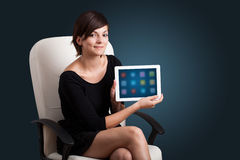 Woman holding modern tablet with colorful icons Stock Image