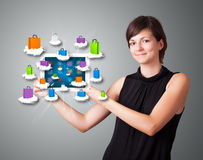 Woman holding modern tablet with colorful shopping bags on cloud Royalty Free Stock Photos