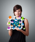 Woman holding modern tablet with colorful shopping bags on cloud Stock Photography
