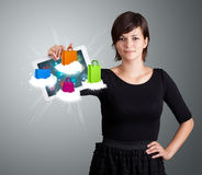 Woman holding modern tablet with colorful shopping bags on cloud. Beautiful woman holding modern tablet with colorful shopping bags on clouds Stock Photos