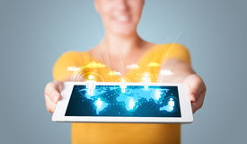 Woman holding modern tablet with social icons Royalty Free Stock Photos