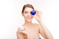 Woman holding moisturizing facial cream Royalty Free Stock Photo