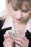 Woman Holding Money. On white background Royalty Free Stock Photography