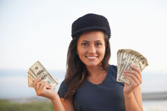 Woman holding money Stock Photography