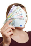 Woman holding money bills on front stock photos
