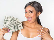 Woman holding money. Happy diverse woman holding wad of money, smiling happily stock photos