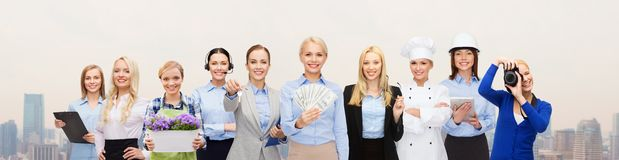 Woman holding money over professional workers Stock Photography