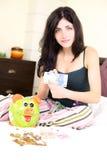 Woman holding money with piggybank happy Stock Photo