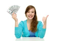 Woman holding money and showing thumbs up Royalty Free Stock Photo