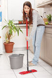 Woman holding a mop Royalty Free Stock Photography