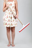 Woman holding a mop Royalty Free Stock Images