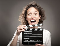 Woman holding a movie clapper board Stock Photography