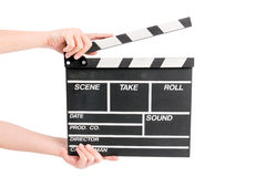 Woman holding movie production clapper board Royalty Free Stock Photo