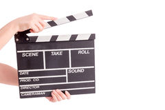 Woman holding movie production clapper board Royalty Free Stock Photos