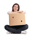 Woman holding moving box Royalty Free Stock Photo