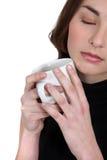 Woman holding mug of coffee Stock Images