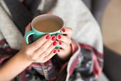 Woman holding mug Stock Photos